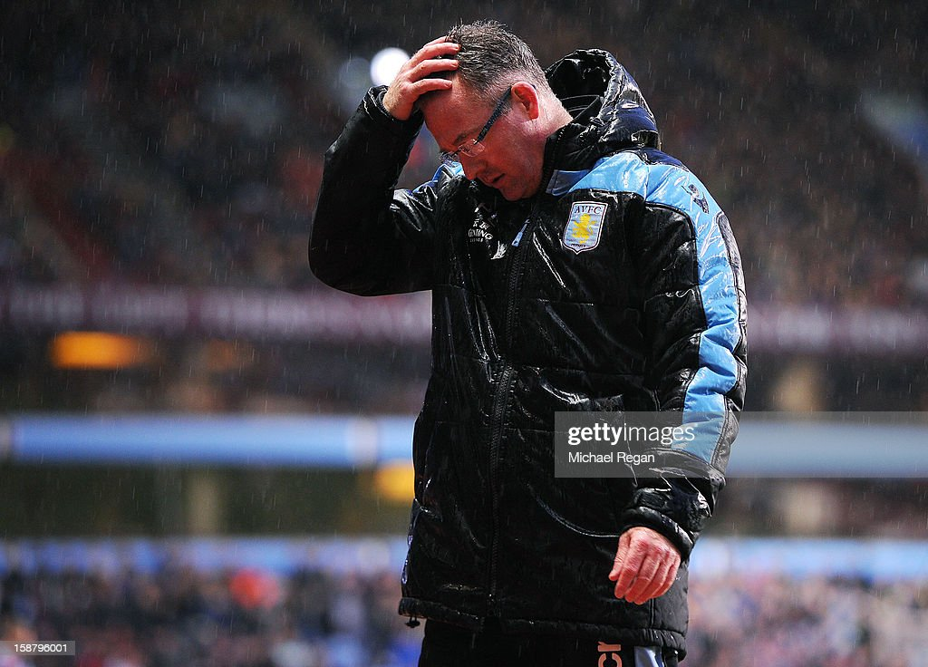 Aston Villa manager Paul Lambert looks dejected in the rain during the Barclays Premier League match between Aston Villa and Wigan Athletic at Villa Park on December 29, 2012 in Birmingham, England.
