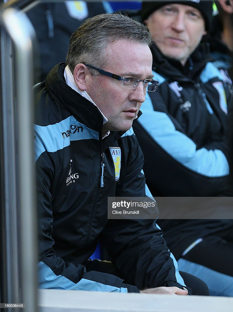 Aston Villa manager Paul Lambert sits in the dug out prior to the start of the Barclays Premier League match between Everton and Aston Villa at Goodison Park on February 2, 2013 in Liverpool, England.
