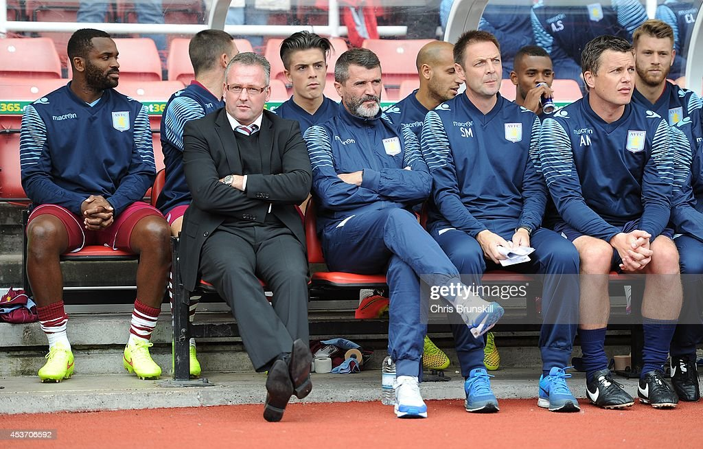 Aston Villa manager Paul Lambert sits next to his assistant Roy Keane during the Barclays Premier League match between Stoke City and Aston Villa on August 16, 2014 in Stoke on Trent, England.