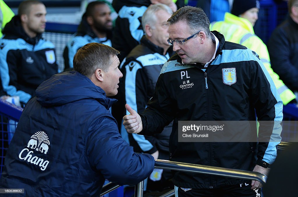Aston Villa manager Paul Lambert with Everton goalkeeping coach Chris Woods prior to the start of the Barclays Premier League match between Everton and Aston Villa at Goodison Park on February 2, 2013 in Liverpool, England.