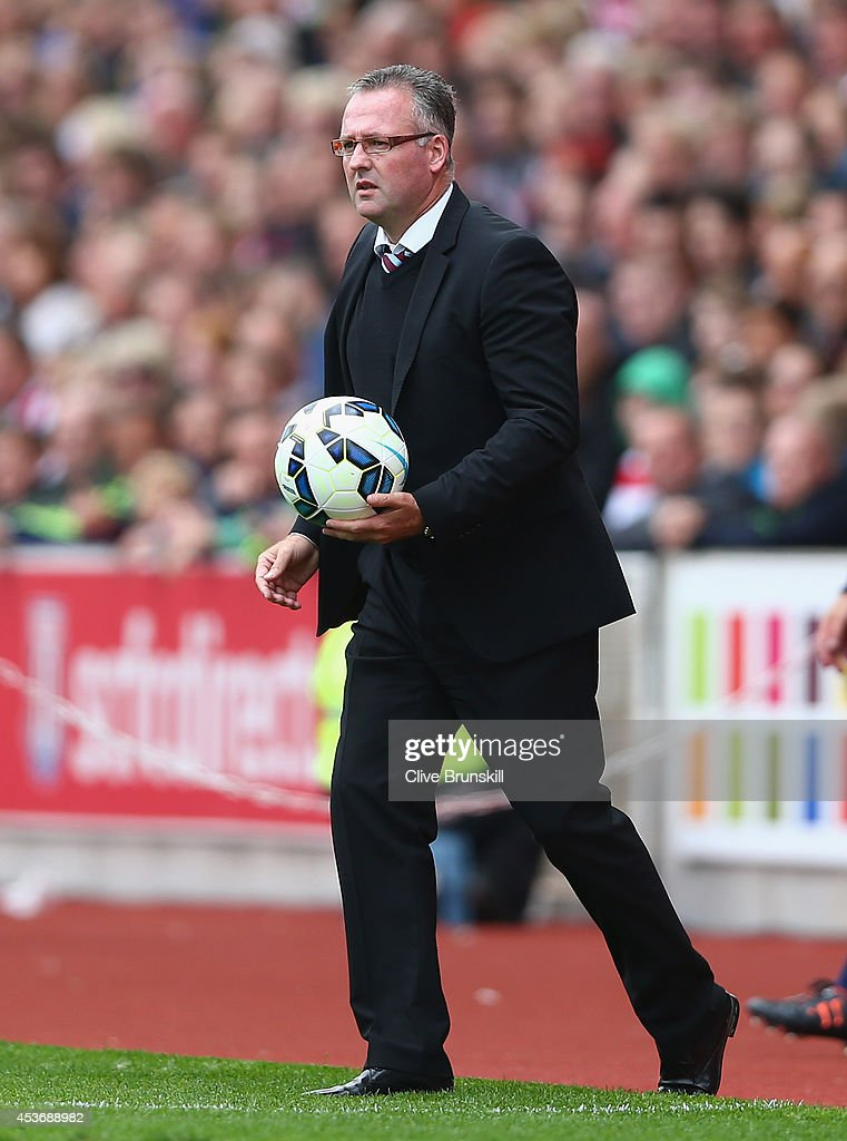 Aston Villa manager Paul Lambert with the match ball during the Barclays Premier League match between Stoke City and Aston Villa at Britannia Stadium on August 16, 2014 in Stoke on Trent, England.
