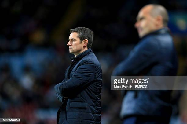 Aston Villa manager Remi Garde stands on the trouchline beyond Everton manager Roberto Martinez