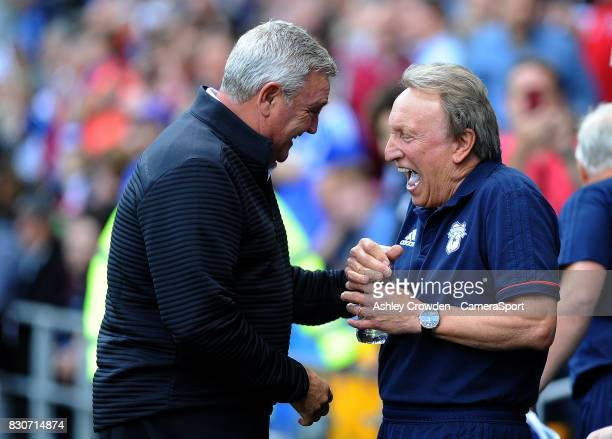Aston Villa manager Steve Bruce and Cardiff City manager Neil Warnock share a joke before the game during the Sky Bet Championship match between...