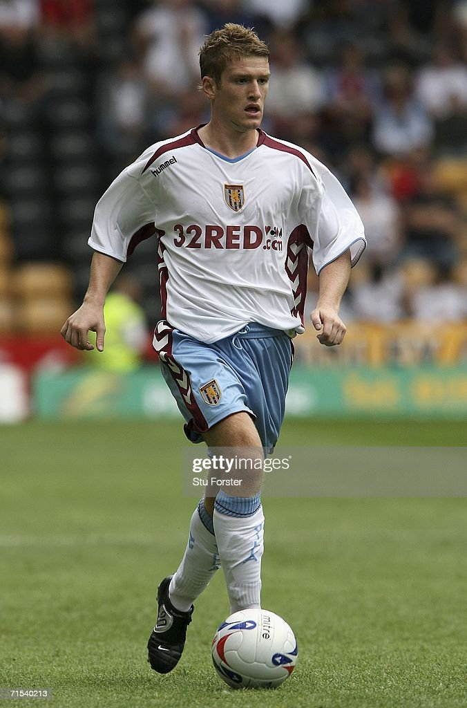 Aston Villa midfielder Steve Davis runs with the ball during the Pre-season friendly match between Wolverhampton Wanderers and Aston Villa at Molineux on July 29, 2006 in Wolverhampton, England.