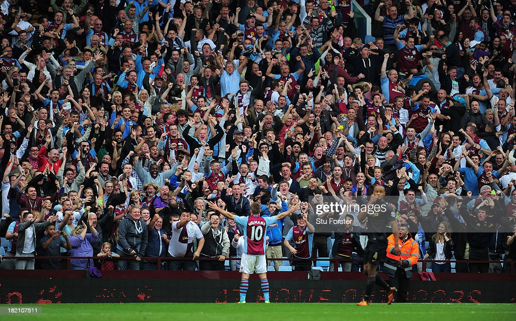 Aston Villa player Andreas Weimann takes the applause of the Holte end after scoring the third Villa goal during the Barclays Premier League match between Aston Villa and Manchester City at Villa Park on September 28, 2013 in Birmingham, England.