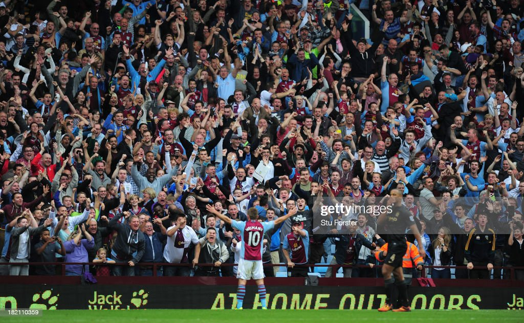 Aston Villa player <a gi-track='captionPersonalityLinkClicked' href=/galleries/search?phrase=Andreas+Weimann&family=editorial&specificpeople=5891558 ng-click='$event.stopPropagation()'>Andreas Weimann</a> takes the applause of the Holte end after scoring the third Villa goal during the Barclays Premier League match between Aston Villa and Manchester City at Villa Park on September 28, 2013 in Birmingham, England.