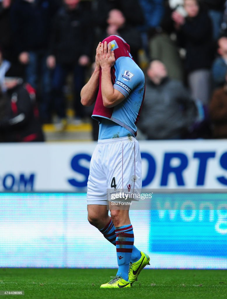 Aston Villa player Ron Vlaar reacts after the Barclays Premier League match between Newcastle United and Aston Villa at St James' Park on February 23, 2014 in Newcastle upon Tyne, England.