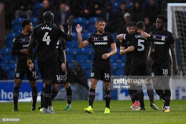 Aston Villa players celebrate their first goal scored by Scott Hogan during the Carabao Cup First Round match between Colchester United and Aston...