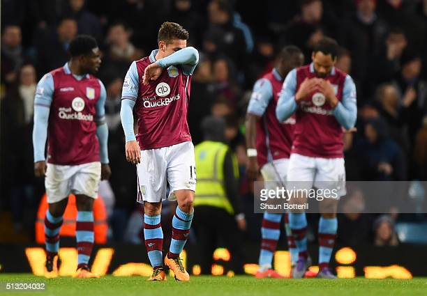 Aston Villa players show their dejection after Everton's third goal during the Barclays Premier League match between Aston Villa and Everton at Villa...