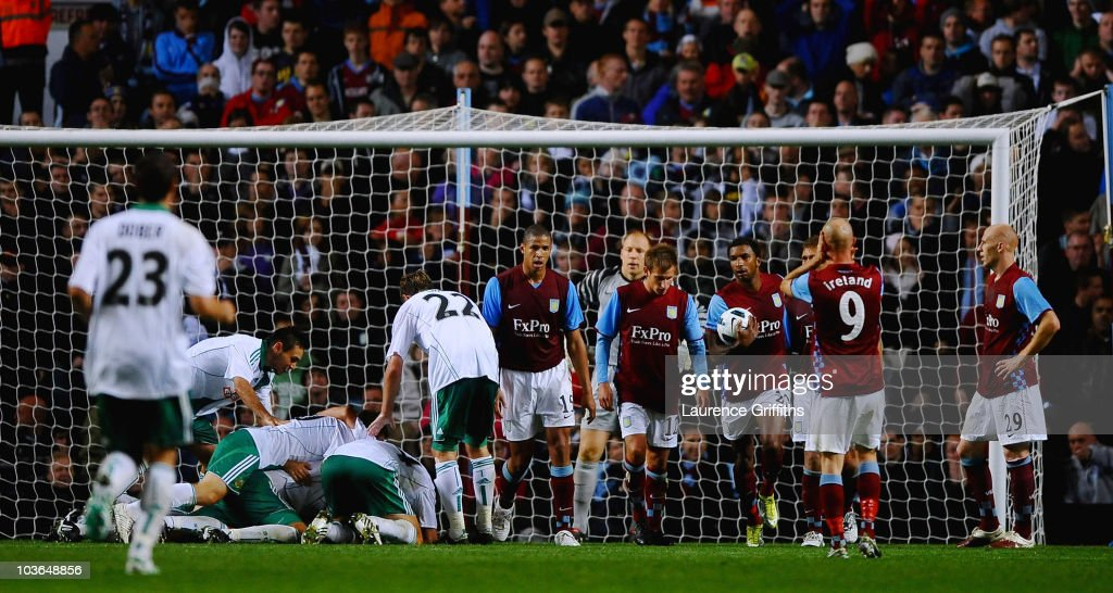 Aston Villa players show their disappointment as conceding the third goal during the UEFA Europa League play off second leg match between Aston Villa and SK Rapid Vienna at Villa Park on August 26, 2010 in Birmingham, England.