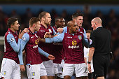 Aston Villa players surround Referee Lee Mason after Gabriel Agbonlahor of Aston Villa fouled Ashley Young of Manchester United during the Barclays...