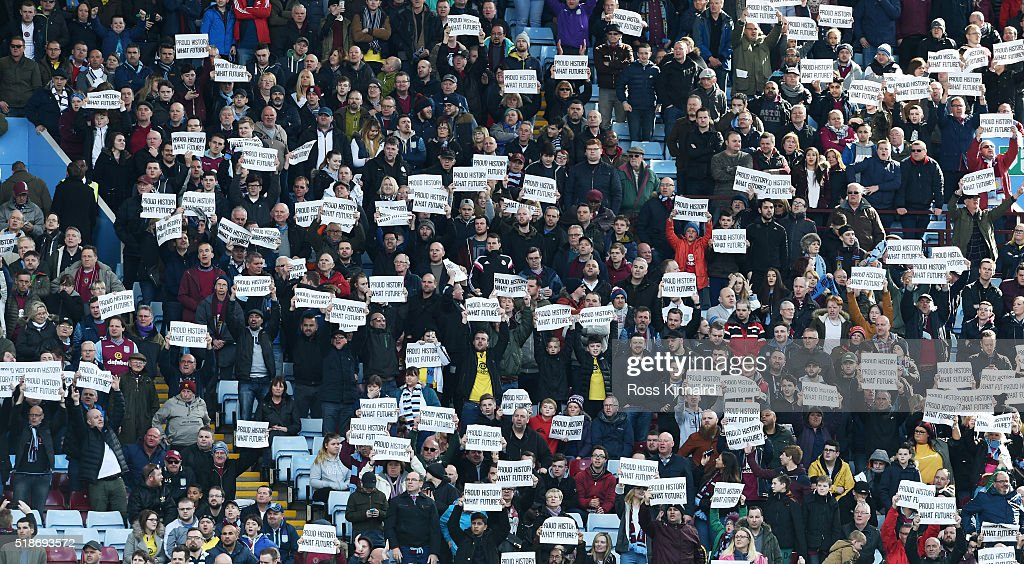 Aston Villa supporters hold protesting banners during the Barclays Premier League match between Aston Villa and Chelsea at Villa Park on April 2, 2016 in Birmingham, England.