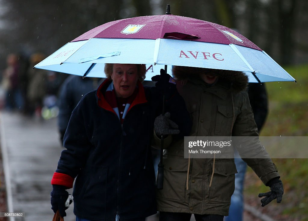 Aston Villa supporters make their way to the stadium prior to the Barclays Premier League match between Aston Villa and Norwich City at Villa Park on February 6, 2016 in Birmingham, England.