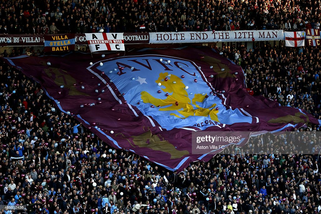 Aston Villa supporters with a giant flag in the Holte End prior to the FA Cup Quarter Final match between Aston Villa and West Bromwich Albion at Villa Park on March 7, 2015 in Birmingham, England.