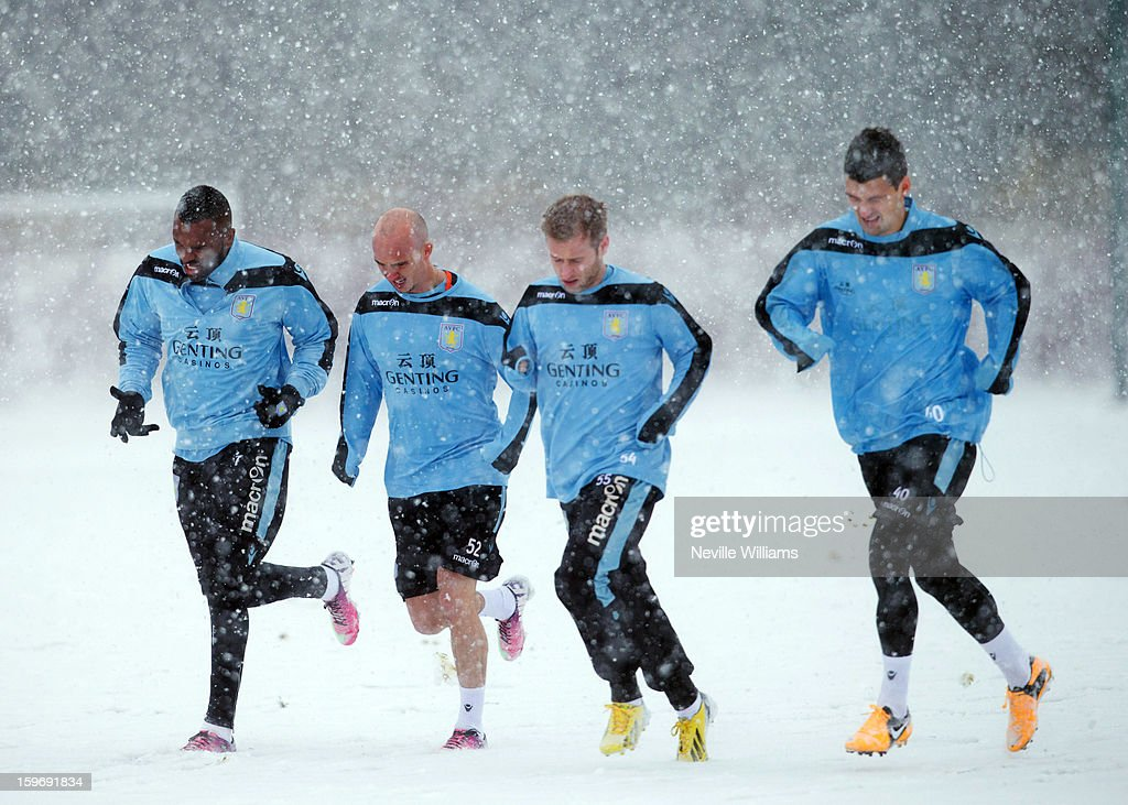 Aston Villa warming up during a very chilly Aston Villa training session at the club's training ground at Bodymoor Heath on January 18, 2013 in Birmingham, England.