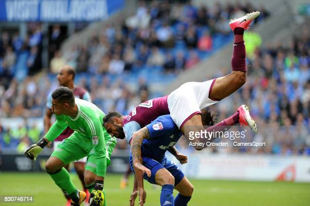 Aston Villa's Ahmed Elmohamady collides with Cardiff City's Lee Camp during the Sky Bet Championship match between Cardiff City and Aston Villa at...