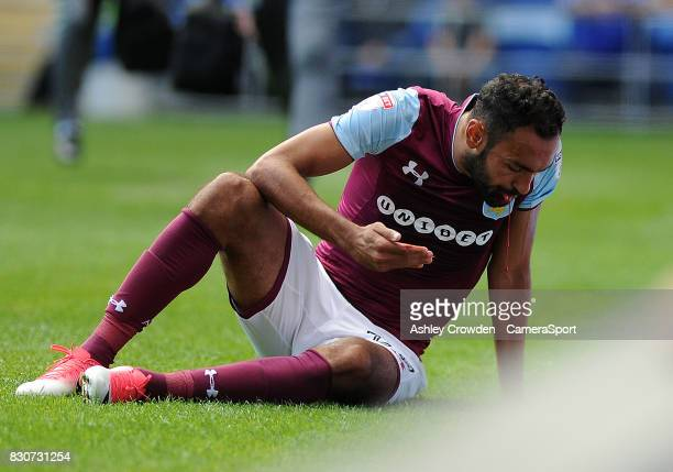 Aston Villa's Ahmed Elmohamady reacts after taking a knock to his face during the Sky Bet Championship match between Cardiff City and Aston Villa at...