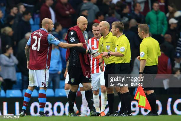 Aston Villa's Alan Hutton has words with referee Mike Jones after the match