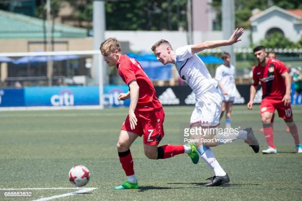 Aston Villa's Alex Prosser competes with Bayer Leverkusen's Tim Handwerker during their Main Tournament match part of the HKFC Citi Soccer Sevens...