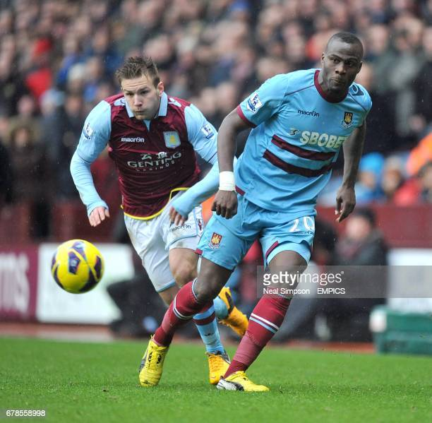 Aston Villa's Andreas Weimann and West Ham United's Guy Demel battle for the ball