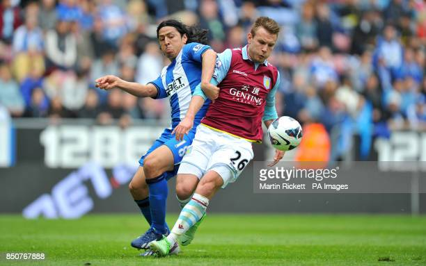 Aston Villa's Andreas Weimann battles for the ball with Wigan Athletic's Roger Espinoza during the Barclays Premier League match against Wigan...