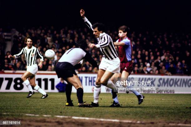 Aston Villa's Andy Blair tries to force the ball past Juventus' Dino Zoff and Gaetano Scirea as Juve's Antonio Cabrini looks on