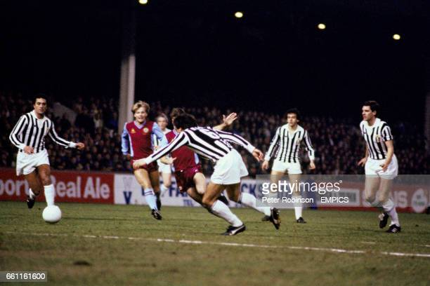 Aston Villa's Andy Blair tries to go past Juventus' Gaetano Scirea watched by teammate Gary Shaw and Juve's Claudio Gentile Michel Platini and Sergio...