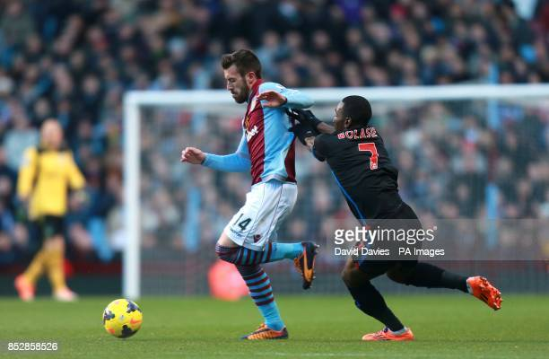Aston Villa's Antonio Luna and Crystal Palace's Yannick Bolasie battle for the ball