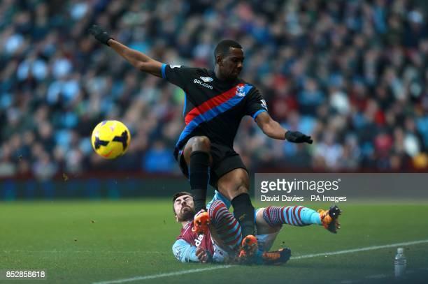 Aston Villa's Antonio Luna tackles Crystal Palace's Yannick Bolasie
