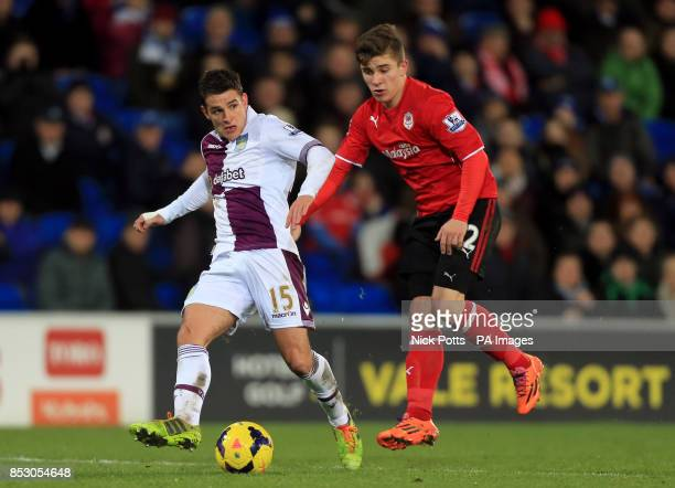 Aston Villa's Ashley Westwood holds off a challenge from Cardiff City's Declan John