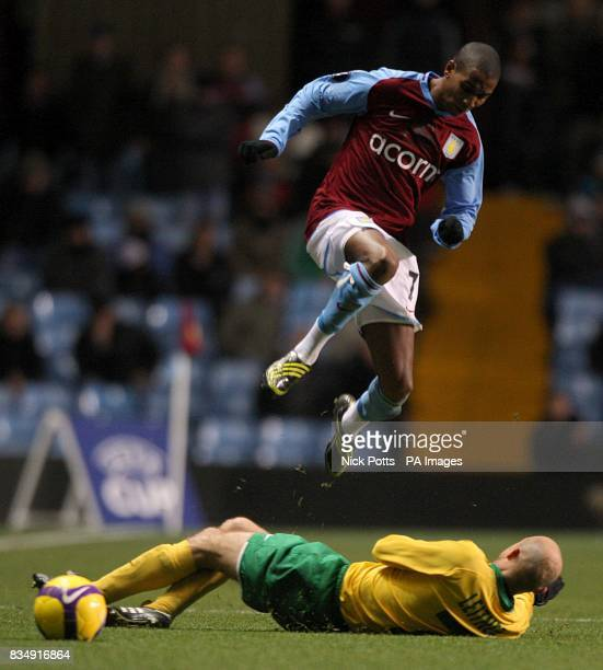 Aston Villa's Ashley Young avoids a tackle from and MSK Zilina's Vladimir Leitner battle for the ball