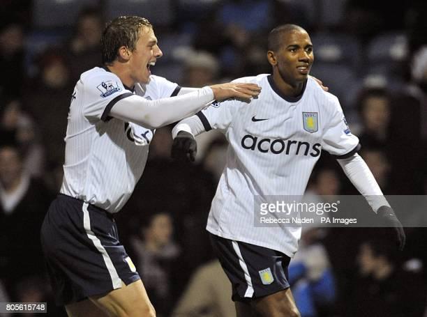 Aston Villa's Ashley Young celebrates scoring their fourth goal with team mate Stephen Warnock