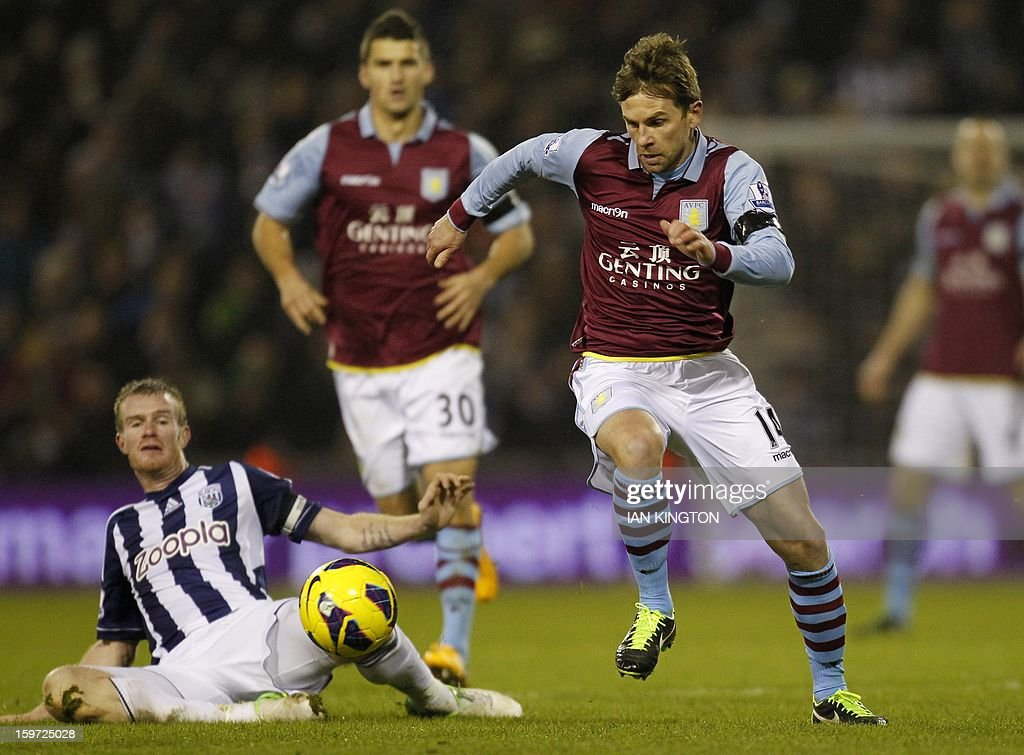 """Aston Villa's Australian striker Brett Holman (R) runs with the ballduring the English Premier League football match between West Bromwich Albion and Aston Villa at The Hawthorns in West Bromwich on January 19, 2013. The match ended in a 2-2 draw. AFP PHOTO/Ian KINGTON - RESTRICTED TO EDITORIAL USE. No use with unauthorized audio, video, data, fixture lists, club/league logos or """"live"""" services. Online in-match use limited to 45 images, no video emulation. No use in betting, games or single club/league/player publications."""
