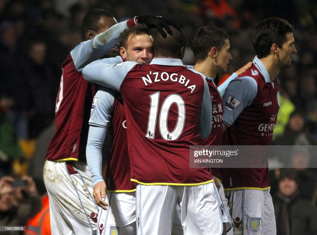 Aston Villa's Austrian striker Andreas Weimann (2nd L) celebrates with teammates after scoring a goal against Norwich City during their English League Cup quarter final football match at Carrow Road stadium in Norwich, east England, on December 12, 2012. Aston Villa won the match 4-1.