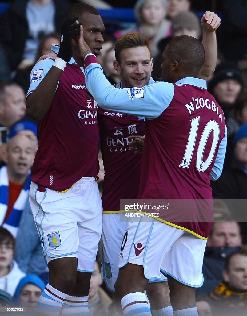 """Aston Villa's Belgian forward Christian Benteke (L) celebrates after scoring with Austrian forward Andreas Weimann (C) and French midfielder Charles N'Zogbia during the English Premier football match between Everton and Aston Villa at Goodison Park in Liverpool, north-west England on February 2, 2013. AFP PHOTO/ANDREW YATES == RESTRICTED TO EDITORIAL USE. No use with unauthorized audio, video, data, fixture lists, club/league logos or """"live"""" services. Online in-match use limited to 45 images, no video emulation. No use in betting, games or single club/league/player publications. =="""
