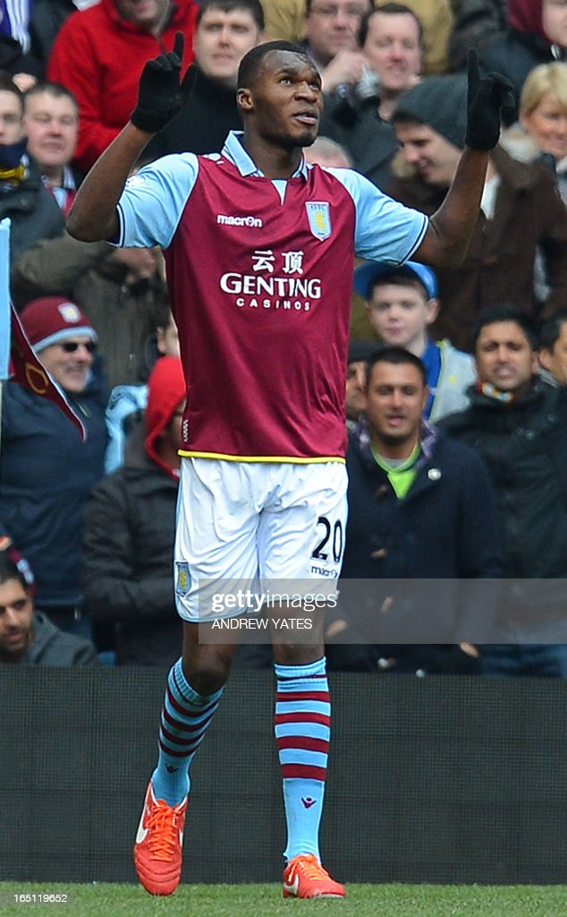 """Aston Villa's Belgian striker Christian Benteke celebrates after scoring the opening goal of the English Premier League football match between Aston Villa and Liverpool at Villa Park in Birmingham, West Midlands, England on March 31, 2013. USE. No use with unauthorized audio, video, data, fixture lists, club/league logos or """"live"""" services. Online in-match use limited to 45 images, no video emulation. No use in betting, games or single club/league/player publications."""