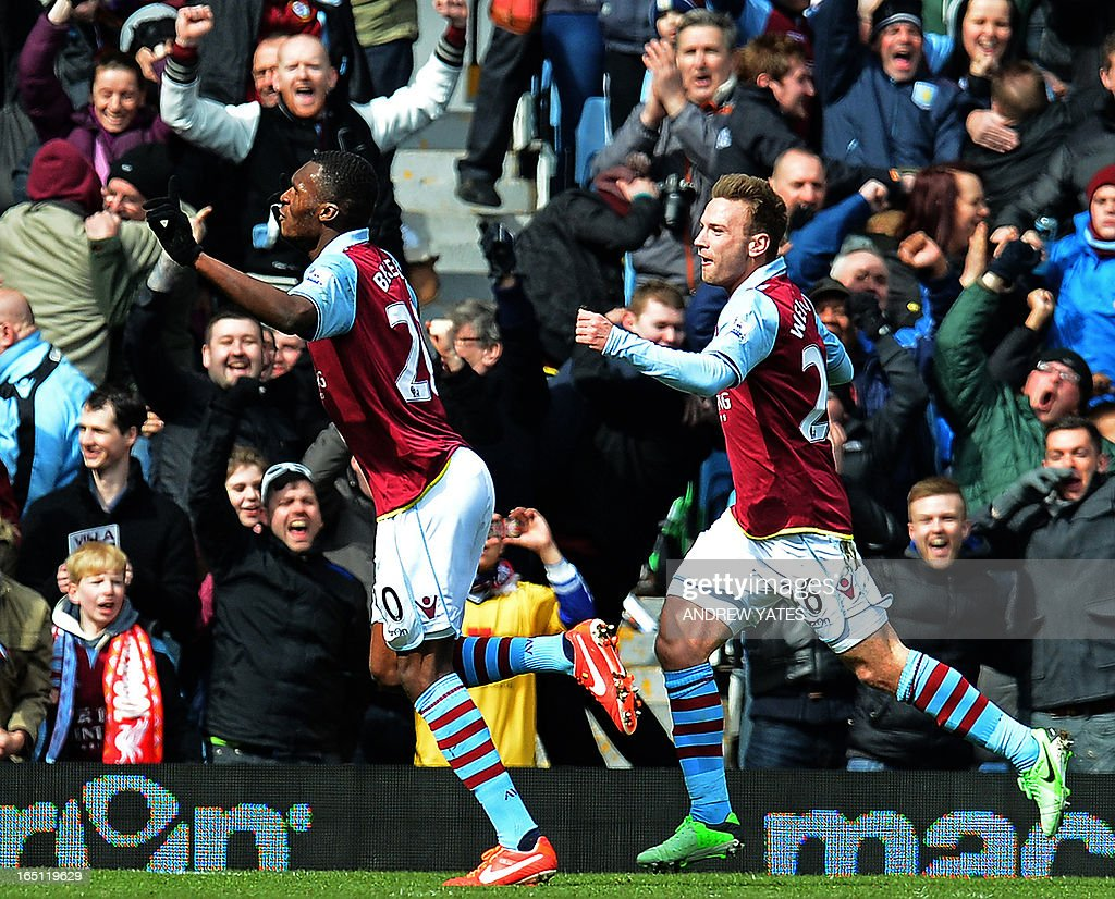 """Aston Villa's Belgian striker Christian Benteke (L) celebrates with Aston Villa's Austrian striker Andreas Weimann (R) after scoring the opening goal of the English Premier League football match between Aston Villa and Liverpool at Villa Park in Birmingham, West Midlands, England on March 31, 2013. USE. No use with unauthorized audio, video, data, fixture lists, club/league logos or """"live"""" services. Online in-match use limited to 45 images, no video emulation. No use in betting, games or single club/league/player publications."""