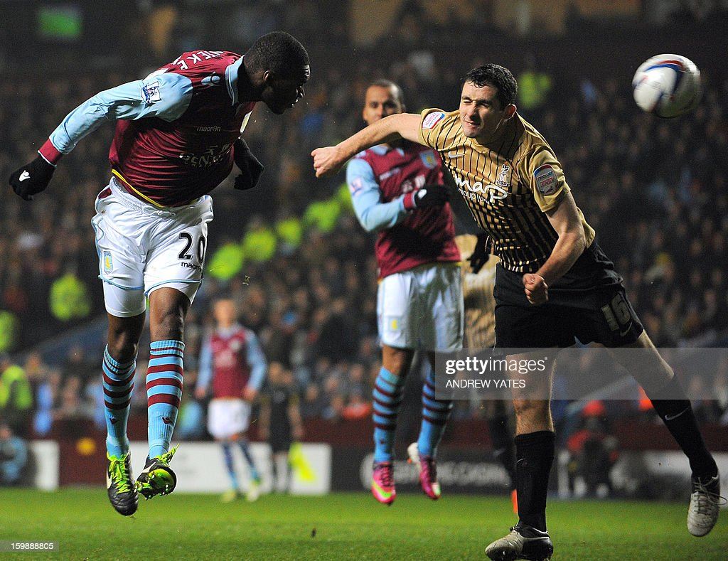 "Aston Villa's Belgium forward Christian Benteke (L) heads past Bradford City's Irish defender Carl McHugh during the English League Cup second leg semi-final football match between Aston Villa and Bradford City at Villa Park, Birmingham, England on January 22, 2013. Fourth-tier Bradford City continued their League Cup fairytale by completing a sensational 4-3 aggregate semi-final win over Aston Villa that sent them into the final. AFP PHOTO/ANDREW YATES == ""RESTRICTED TO EDITORIAL USE. No use with unauthorized audio, video, data, fixture lists, club/league logos or ""live"" services. Online in-match use limited to 45 images, no video emulation. No use in betting, games or single club/league/player publications."" =="