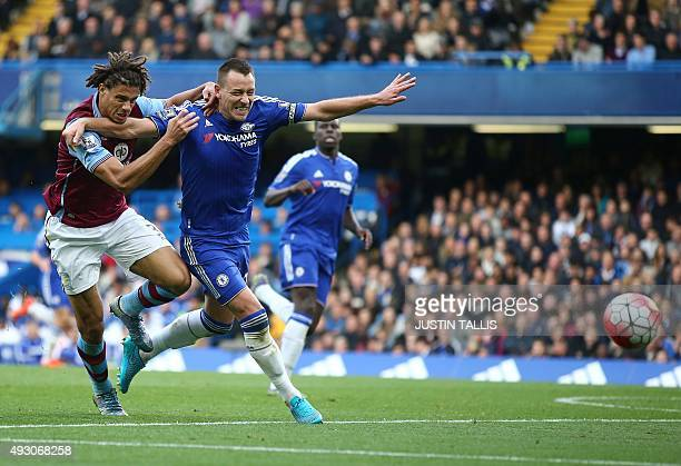Aston Villa's Benin striker Rudy Gestede vies for the ball with Chelsea's English defender John Terry during the English Premier League football...