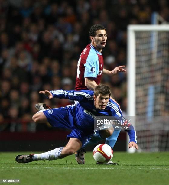 Aston Villa's Carlos Cuellar and Ajax's KlaasJan Huntelaar battle for the ball