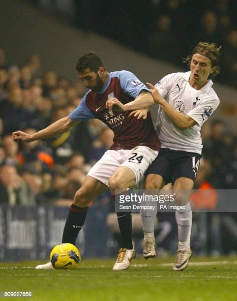Aston Villa's Carlos Jimenez Cuellar and Tottenham Hotspur's Luka Modric in action