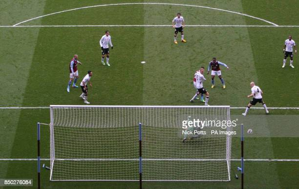 Aston Villa's Charles N'Zogbia sees his shot saved by Fulham goalkeeper Mark Schwarzer