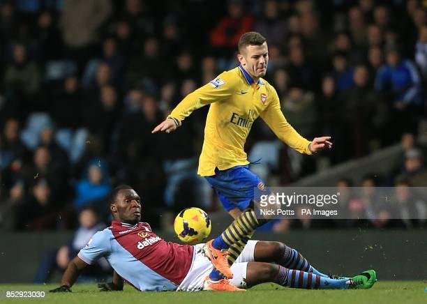 Aston Villa's Christian Benteke and Arsenal's Jack Wilshere battle for the ball