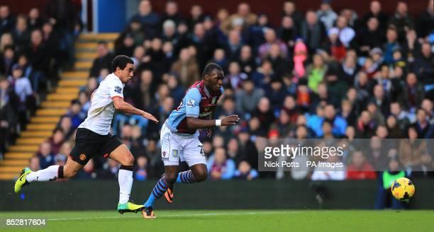 Aston Villa's Christian Benteke and Manchester United's Rafael Da Silva chase down the ball