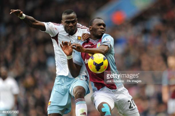 Aston Villa's Christian Benteke and West Ham United's Guy Demel battle for the ball during the Barclays Premier League match at Villa Park Birmingham