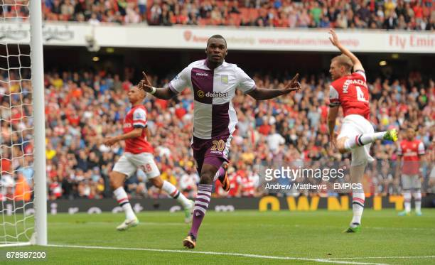 Aston Villa's Christian Benteke celebrates after he scores his side's equalising goal from header after his penalty was rebounded after being saved...