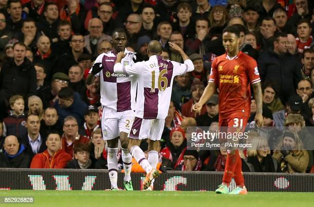 Aston Villa's Christian Benteke celebrates scoring their second goal of the game with teammate Fabian Delph as Liverpool's Raheem Sterling stands...