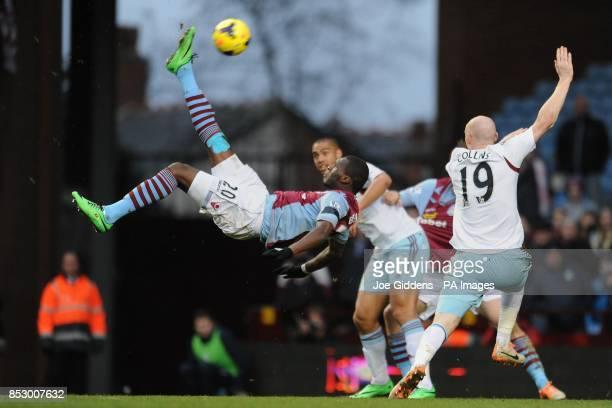 Aston Villa's Christian Benteke executes an overhead kick during the Barclays Premier League match at Villa Park Birmingham
