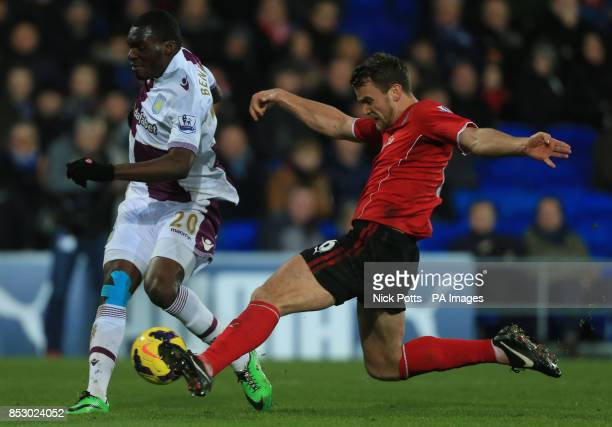 Aston Villa's Christian Benteke has his shot at goal blocked by Cardiff City's Ben Turner tackle during the Barclays Premier League match at the...
