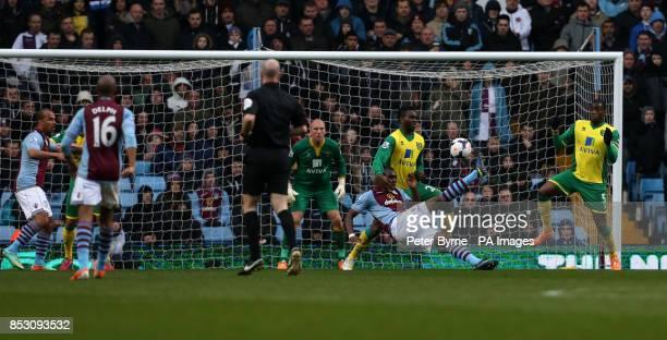 Aston Villa's Christian Benteke scores his first goal during the Barclays Premier League match at Villa Park Birmingham